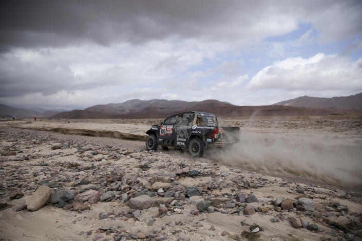 Driver Benediktas Vanagas, of Lithuania, and co-driver Sebastian Rozwadowski, of Poland, race their Toyota during stage four of the Dakar Rally between Arequipa and Moquegua, Peru, Thursday, Jan. 10, 2019. (AP Photo/Ricardo Mazalan)