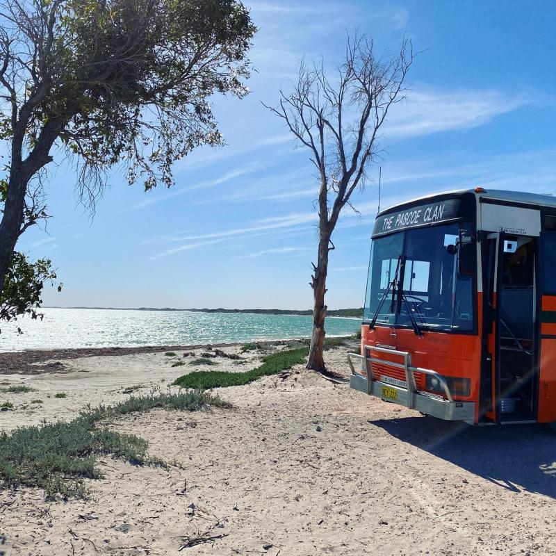 The Pascoe family bus parked near a beach in Western Australia
