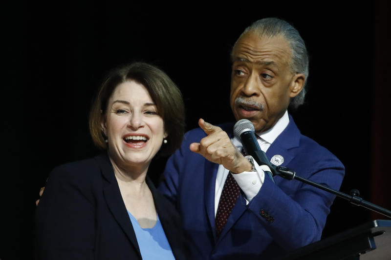 Democratic presidential candidate Sen. Amy Klobuchar, D-Minn., stands with Rev. Al Sharpton after speaking at the National Action Network South Carolina Ministers' Breakfast, Wednesday, Feb. 26, 2020, in North Charleston, S.C. (AP Photo/Matt Rourke)