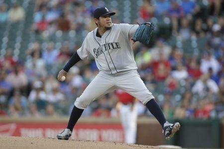 Aug 7, 2018; Arlington, TX, USA; Seattle Mariners starting pitcher Felix Hernandez (34) pitches against the Texas Rangers in the first inning at Globe Life Park in Arlington. Mandatory Credit: Tim Heitman-USA TODAY Sports