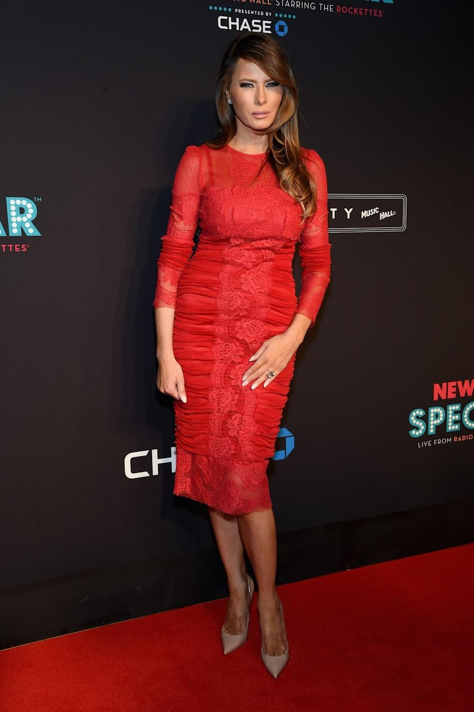<p>Melania attended an event in New York wearing a rushed red dress complete with lacy detailing and a pair of nude stilettos. <i>[Photo: Getty]</i> </p>