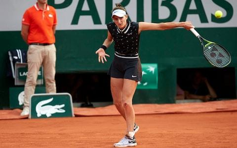 Marketa Vondrousova of The Czech Republic returns the ball in her ladies singles quarter-final match against Petra Martic of Croatia during Day ten of the 2019 French Open at Roland Garros on June 04, 2019 in Paris, France - Credit: Getty Images