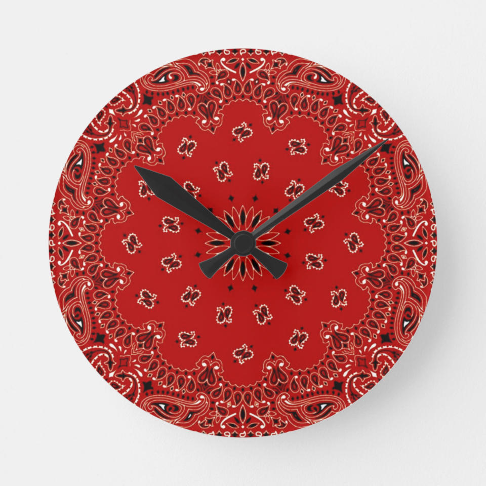 This image released by Zazzle shows a wall clock that features a bandana print. Zazzle has melamine plates, ceramic mugs, and ceiling and table lamps featuring the bandana paisley motif, in vibrant hues of red, blue, purple, turquoise, green or gold. (Zazzle via AP)