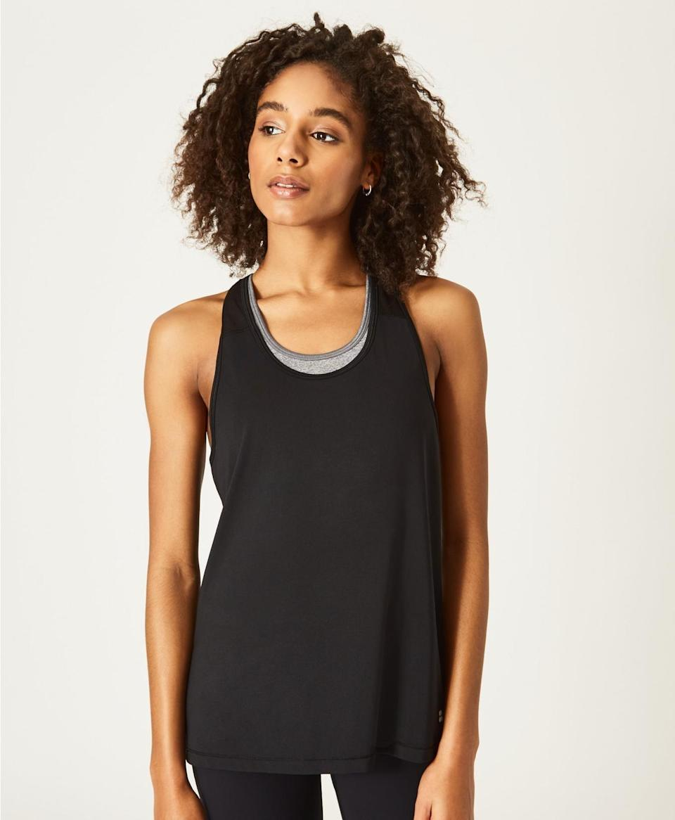 "<p>You can do anything in this <a href=""https://www.popsugar.com/buy/Sweaty-Betty-Compound-Tank-477145?p_name=Sweaty%20Betty%20Compound%20Tank&retailer=sweatybetty.com&pid=477145&price=50&evar1=fit%3Auk&evar9=46472938&evar98=https%3A%2F%2Fwww.popsugar.com%2Ffitness%2Fphoto-gallery%2F46472938%2Fimage%2F46473366%2FSweaty-Betty-Compound-Tank&list1=shopping%2Cworkout%20clothes%2Cfitness%20gear%2Cproducts%20under%20%2450%2C50%20under%20%2450%2Cfitness%20shopping%2Caffordable%20shopping&prop13=api&pdata=1"" class=""link rapid-noclick-resp"" rel=""nofollow noopener"" target=""_blank"" data-ylk=""slk:Sweaty Betty Compound Tank"">Sweaty Betty Compound Tank</a> ($50).</p>"