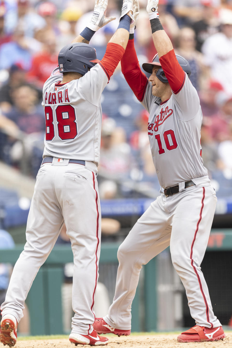 Washington Nationals' Yan Gomes (10) celebrates with Gerardo Parra (88) after hitting a two-run home run during the seventh inning of a baseball game against the Philadelphia Phillies, Thursday, July 29, 2021, in Philadelphia in the first game of a double header. (AP Photo/Laurence Kesterson)