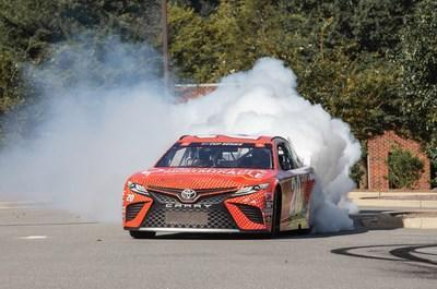 The paint scheme was unveiled in a victory-lane style burnout.