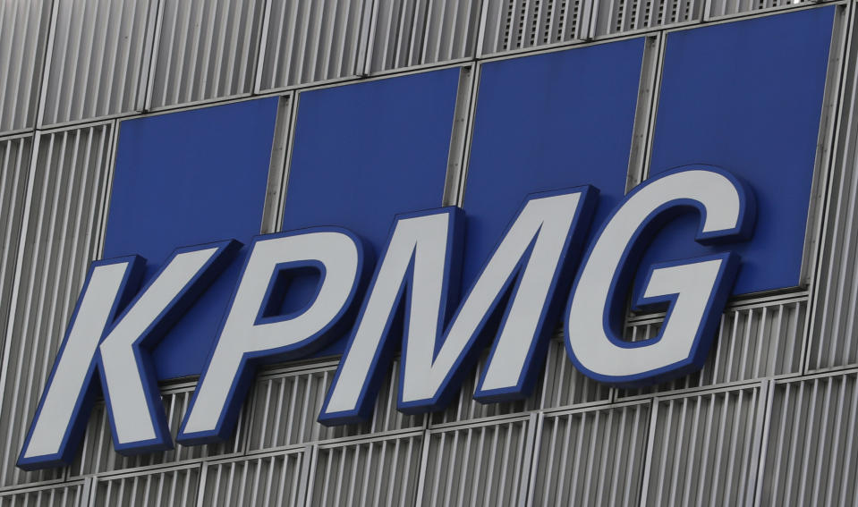 The KPMG logo is seen at their offices at Canary Wharf financial district in London,Britain, March 3, 2016.  REUTERS/Reinhard Krause