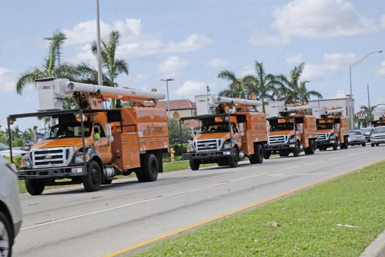 Utility trucks head for the Florida Keys as part of a massive effort to restore power following Hurricane Irma