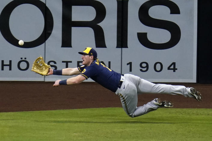 Milwaukee Brewers left fielder Billy McKinney makes a diving catch for the out on San Diego Padres' Wil Myers during the fourth inning of a baseball game Tuesday, April 20, 2021, in San Diego. (AP Photo/Gregory Bull)