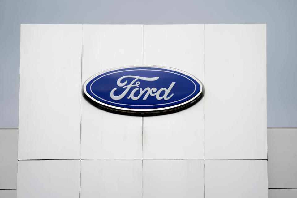 A Ford logo is seen on signage at Country Ford in Graham, N.C., Tuesday, July 27, 2021. Sky-high sales prices for its pickup trucks and SUVs helped Ford Motor Co. turn a surprise second-quarter profit despite a global shortage of computer chips that cut production. (AP Photo/Gerry Broome)