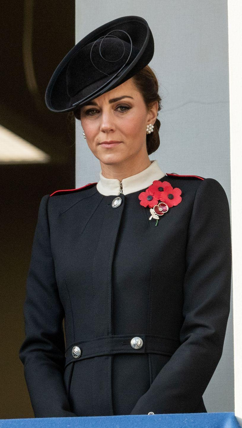 """<p>Duchess Kate attended the somber Remembrance Sunday memorial at the Cenotaph in London<a href=""""https://www.townandcountrymag.com/style/fashion-trends/a24851861/kate-middleton-black-coat-pippy-pin-remembrance-sunday-2018-photos/"""" rel=""""nofollow noopener"""" target=""""_blank"""" data-ylk=""""slk:wearing a black Alexander McQueen coat"""" class=""""link rapid-noclick-resp""""> wearing a black Alexander McQueen coat</a> with a crimson poppy pin on the front.</p>"""