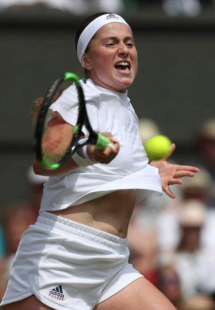Tennis - Wimbledon - All England Lawn Tennis and Croquet Club, London, Britain - July 12, 2018. Latvia's Jelena Ostapenko in action during her semi final match against Germany's Angelique Kerber. Jonathan Brady/pool via Reuters