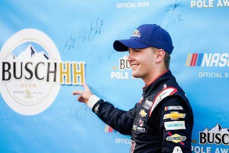 May 23, 2019; Concord, NC, USA; Monster Energy NASCAR Cup Series driver William Byron (24) celebrates winning the Busch pole during qualifying for the Coca-Cola 600 at Charlotte Motor Speedway. Mandatory Credit: Jim Dedmon-USA TODAY Sports