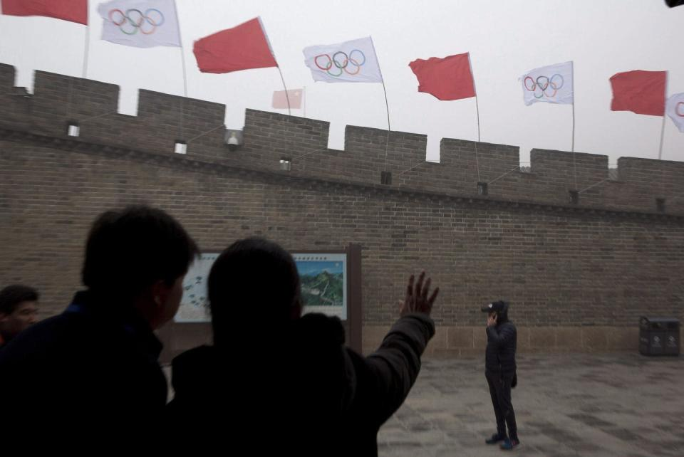 "<span class=""caption"">Olympic flags fly over a section of Great Wall of China to mark the 2022 Winter Olympic Games in Beijing. </span> <span class=""attribution""><span class=""source"">(AP Photo/Ng Han Guan)</span></span>"
