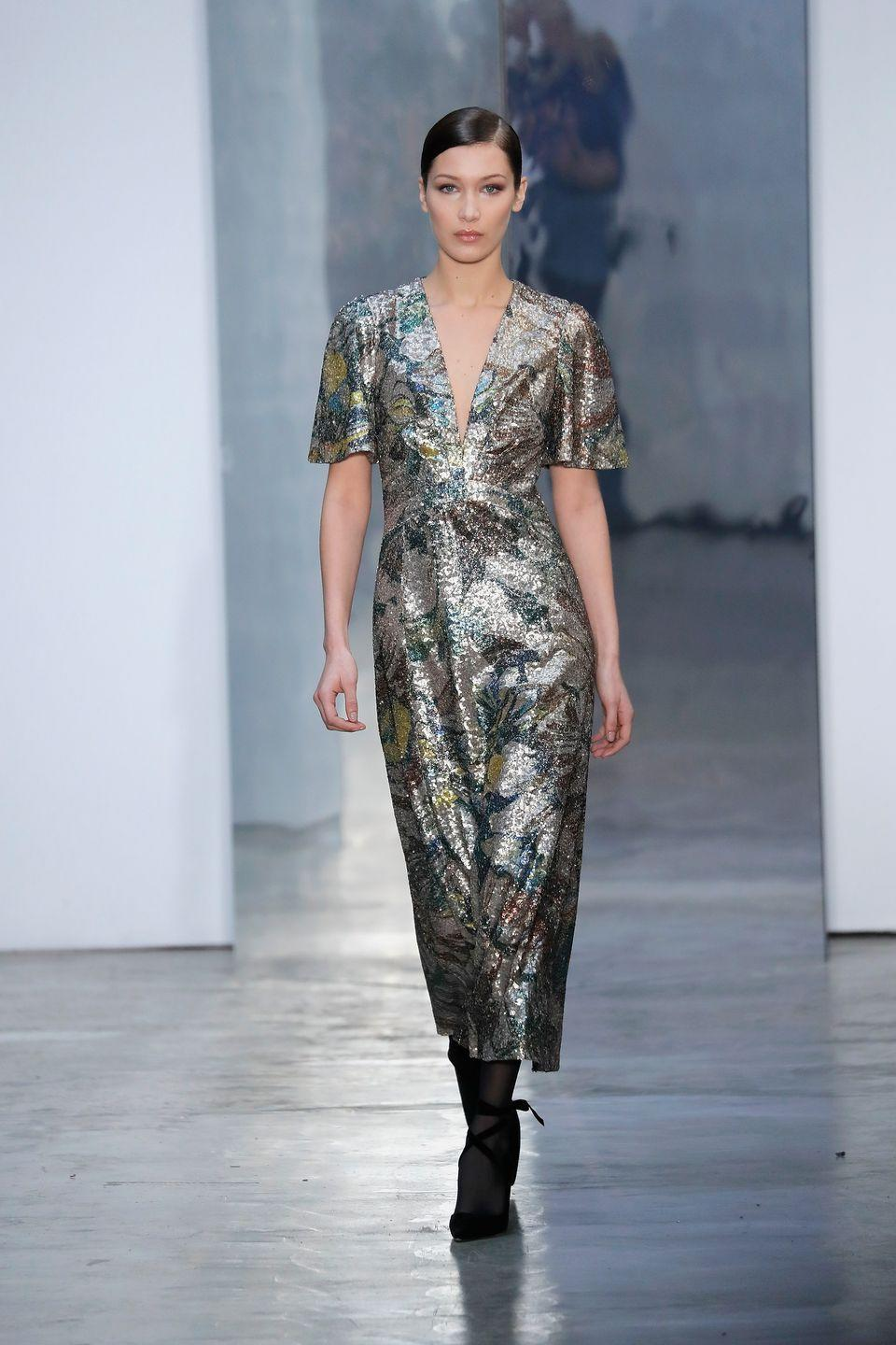 <p>Bella Hadid stormed the runway for Carolina Herrera's AW17 collection at NYFW</p>