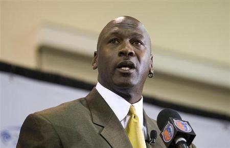 New Charlotte Bobcats majority owner Michael Jordan speaks during a news conference in Charlotte, North Carolina March 18, 2010. REUTERS/Chris Keane/Files