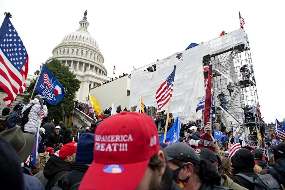 A mob surrounds the U.S. Capitol on Jan. 6