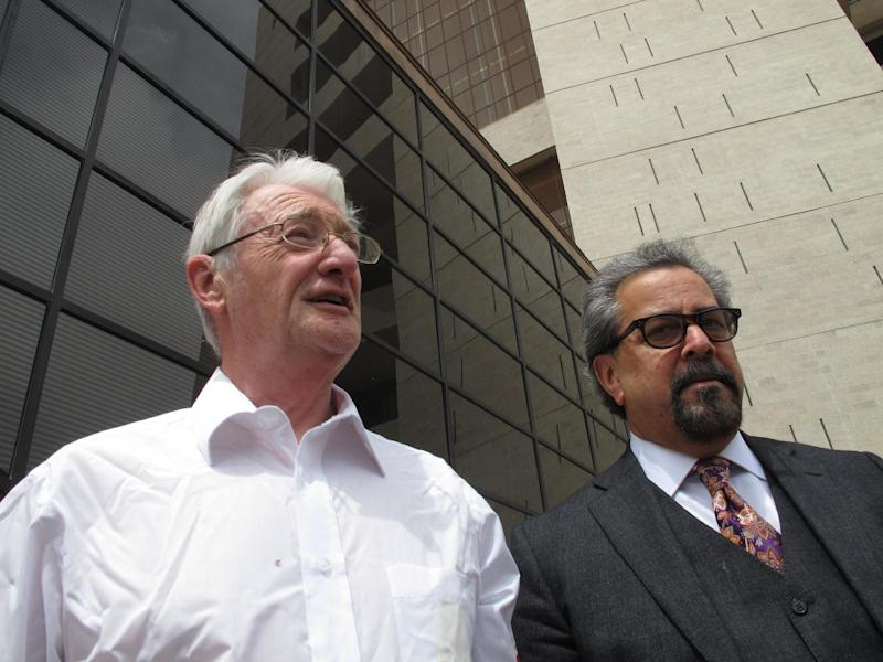 FILE  - In this April 25, 2012 file photo, Christopher Tappin, left, leaves federal court with one of his lawyers, Kent Schaffer, in El Paso, Texas. A federal judge has scheduled a new plea hearing Thursday, Nov. 1, 2012 in federal court in Texas for Tappin, the British man accused of trying to buy missile parts from undercover U.S. agents and illegally sell them to Iran. (AP Photo/Juan Carlos Llorca, File)