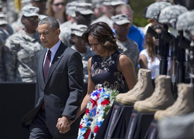 President Barack Obama and first lady Michelle Obama arrive for a memorial ceremony, Wednesday, April 9, 2014, at Fort Hood Texas, for those killed there in a shooting last week. President Barack Obama is reprising his role as chief comforter as he returns once again to a grief-stricken corner of America to mourn with the families of those killed last week at Fort Hood and offer solace to the nation.(AP Photo/Carolyn Kaster)
