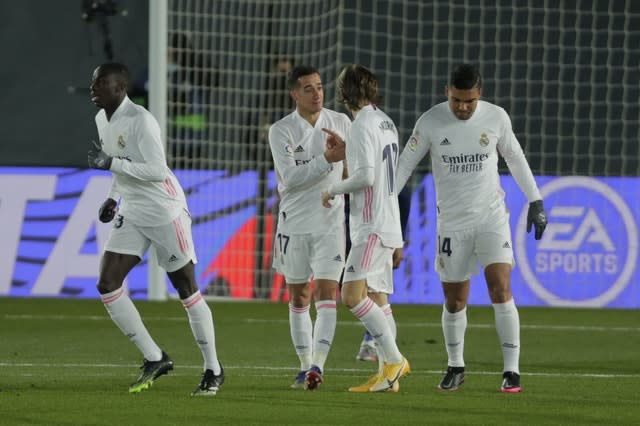 Real Madrid's Lucas Vazquez (second right) celebrates with team-mates after scoring a goal