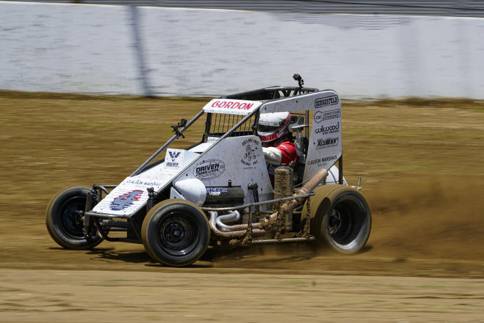 Jeff Gordon, a five-time winner of the Brickyard 400 and four-time NASCAR Cup Series champion, drives through a turn in a USAC midget car during an exhibition on the dirt track in the infield at Indianapolis Motor Speedway in Indianapolis, Thursday, June 17, 2021. (AP Photo/Michael Conroy)