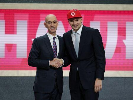 Luka Doncic greets NBA commissioner Adam Silver (L) after being selected as the number three overall pick to the Atlanta Hawks in the first round of the 2018 NBA Draft at the Barclays Center in Brooklyn, NY, U.S., June 21, 2018. Brad Penner-USA TODAY Sports