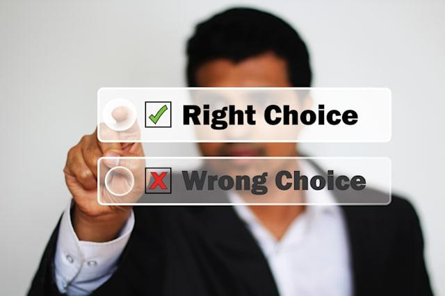 Right Choice Selected by an Young male Professional as against another Wrong Choice by clicking the button