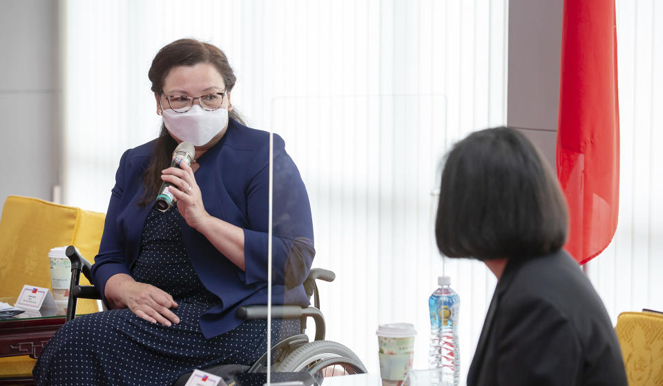 In this photo released by the Taiwan Presidential Office, U.S. Democratic Sen. Tammy Duckworth of Illinois speaks during a meeting with Taiwan President Tsai Ing-wen, right, in Taipei, Taiwan on Sunday, June 6, 2021. The U.S. will give Taiwan 750,000 doses of COVID-19 vaccine, part of President Joe Biden's move to share tens of millions of jabs globally, three American senators said Sunday, after the self-ruled island complained that China is hindering its efforts to secure vaccines as it battles an outbreak. (Taiwan Presidential Office via AP)
