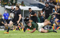 New Zealand's Brad Weber runs past South Africa's Malcolm Marx during the Rugby Championship test match between the Springboks and the All Blacks in Townsville, Australia, Saturday, Sept. 25, 2021. (AP Photo/Tertius Pickard)