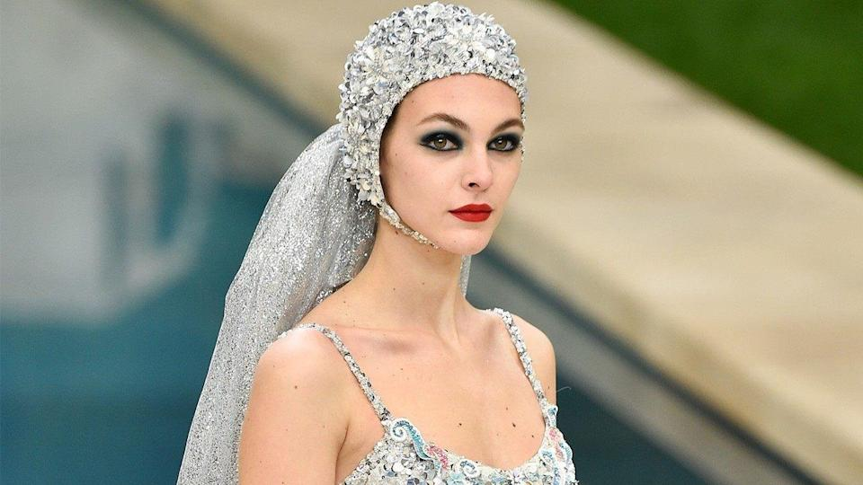 Forget wedding dresses! Chanel's take on bridal includes an embellished cut-out swimsuit complete with sequined veil and cap.