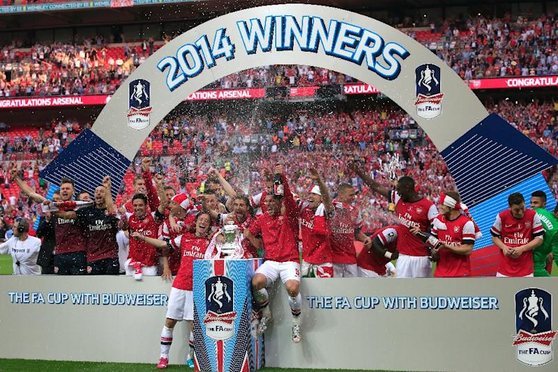 Arsenal Celebrate With The Trophy After Winning FA Cup Final Against Hull City At Wembly