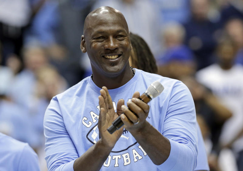 FILE - In this March 4, 2017, file photo, former North Carolina basketball player Michael Jordan applauds during a half-time presentation at an NCAA college basketball game between North Carolina and Duke in Chapel Hill, N.C. Jordan, who played high school basketball in Wilmington, N.C., one of the areas hardest hit by Hurricane Florence, has donated $2 million to assist residents affected by the hurricane. (AP Photo/Gerry Broome, File)