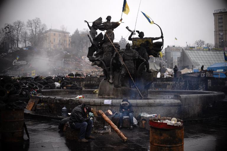 Men rest near a barricade on Independence square in central Kiev on March 3, 2014