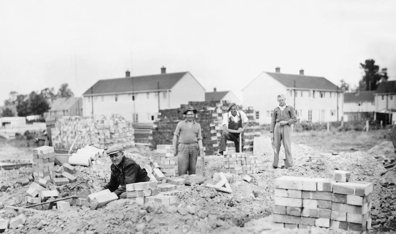 <p>Wisbey builders from nearby Haslingfield, constructing a large estate of brick council houses in Medcalf Way, Melbourn, Cambridgeshire, 1950s (mediadrumworld/Caters) </p>
