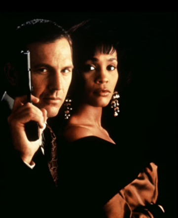 <p>Some would say that the love story is secondary, but the unspoken bond between Rachel and Frank is part of the reason for the movie's blockbuster success. Frank, a professional bodyguard, is hired to protect Rachel, an actress and singer, after she receives death threats from a stalker. The two disagree on a lot of things, but eventually bond after a riot at one of her concerts. After they sleep together, Frank realizes it's a conflict of interest and breaks things off. Rachel, a woman scorned, starts acting out and puts herself in danger. Frank took a bullet for Rachel, but recovers. Their love story never forms into a relationship, as the two say goodbye with one last kiss.<br></p>