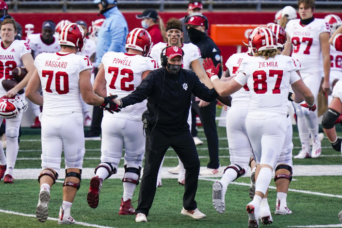 Indiana coach Tom Allen congratulates players during the second quarter of an NCAA college football game against Rutgers, Saturday, Oct. 31, 2020, in Piscataway, N.J. (AP Photo/Corey Sipkin)