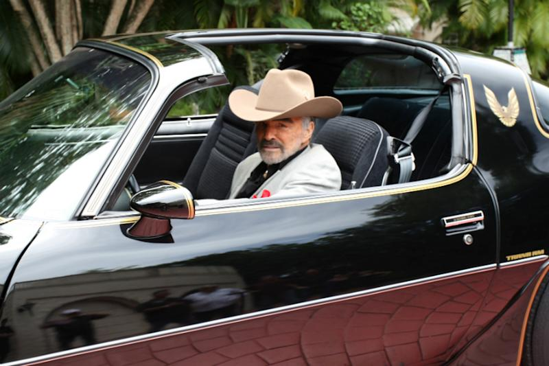 Burt Reynolds sits in a 1979 Pontiac Trans Am, which was the last Trans Am owned and driven by Reynolds, in this Julien's Auctions photo. (Image: Reuters)