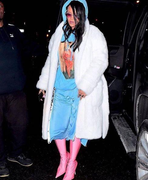 <p>In a blue ensemble, pink Balenciaga boots, and a white Alexander Wang mink robe while out in NYC.</p>