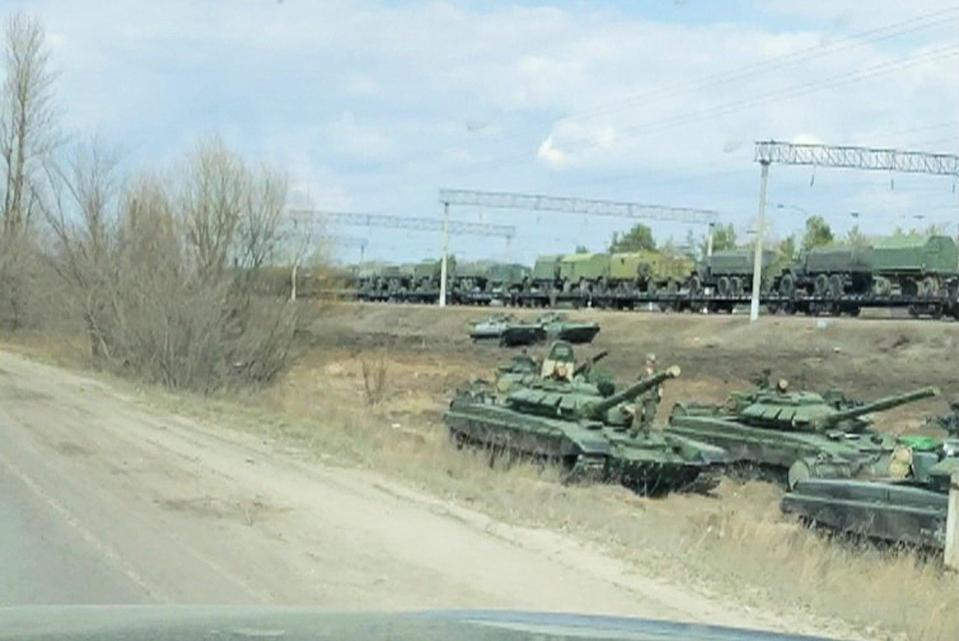 <p>A still image from video shows tanks and military vehicles in Maslovka, Voronezh Region, Russia</p> (REUTERS)