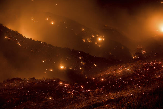 <p>A hillside glows with embers as the Thomas fire burns through Los Padres National Forest near Ojai, Calif., on Friday, Dec. 8, 2017. (Photo: Noah Berger/AP) </p>