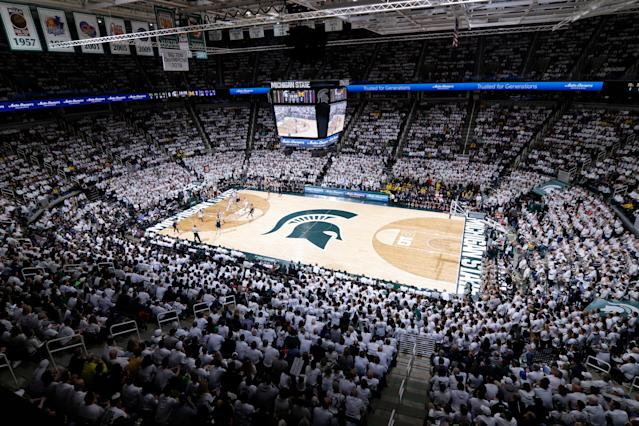 Fans watch the first half of an NCAA college basketball game between Michigan State and Michigan, Saturday, March 9, 2019, in East Lansing, Mich. (AP Photo/Al Goldis)