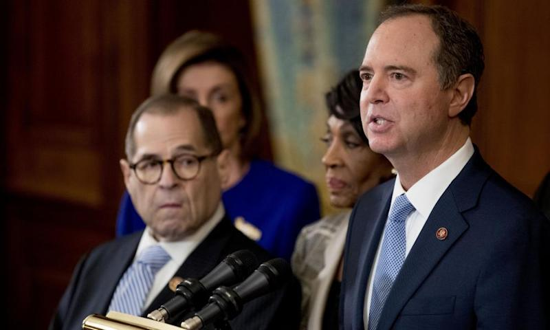 Adam Schiff, Chairman of the House Intelligence Committee, right, speaks during a news conference to unveil articles of impeachment against President Donald Trump.