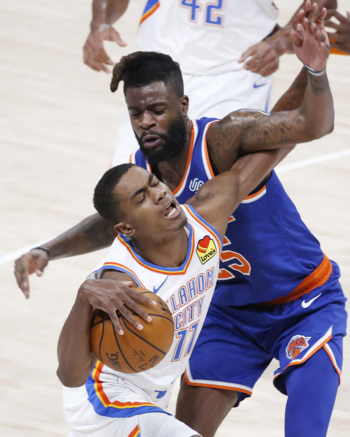Oklahoma City Thunder guard Theo Maledon (11) is fouled by New York Knicks forward Reggie Bullock (25) during the first half of an NBA basketball game, Saturday, March 13, 2021, in Oklahoma City. (AP Photo/Garett Fisbeck)