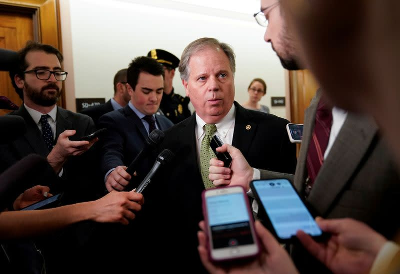 FILE PHOTO: U.S. Senator Doug Jones arrives for briefing on corona virus on Capitol Hill in Washington