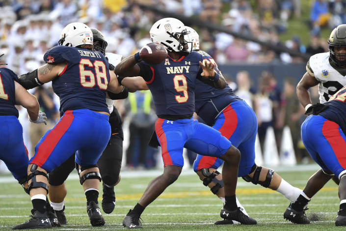 Navy quarterback Maasai Maynor (9) looks to pass the ball during second half of the team's NCAA college football game against Air Force, Saturday, Sept. 11, 2021, in Annapolis, Md. (AP Photo/Terrance Williams)