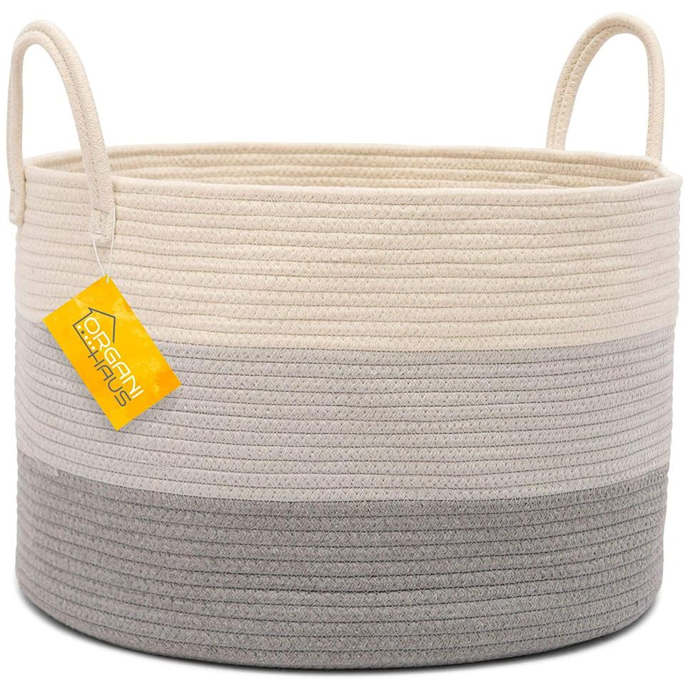 "<p>Stash everything from blankets to laundry in this easily totable ombré <a href=""https://www.popsugar.com/buy/OrganiHaus-XXL-Cotton-Rope-Basket-522783?p_name=OrganiHaus%20XXL%20Cotton%20Rope%20Basket&retailer=amazon.com&pid=522783&price=29&evar1=casa%3Aus&evar9=46938975&evar98=https%3A%2F%2Fwww.popsugar.com%2Fphoto-gallery%2F46938975%2Fimage%2F46938977%2FOrganiHaus-XXL-Cotton-Rope-Basket&list1=amazon%2Corganizing%2Cstorage%2Chome%20shopping&prop13=api&pdata=1"" rel=""nofollow"" data-shoppable-link=""1"" target=""_blank"" class=""ga-track"" data-ga-category=""Related"" data-ga-label=""https://www.amazon.com/OrganiHaus-Blanket-Storage-Decorative-Blankets/dp/B07C7HQVCM/ref=sr_1_17?crid=17X7BZIGH2RUV&amp;keywords=baskets+for+organizing&amp;qid=1574473449&amp;s=home-garden&amp;sprefix=basket%2Cgarden%2C143&amp;sr=1-17"" data-ga-action=""In-Line Links"">OrganiHaus XXL Cotton Rope Basket</a> ($29).</p>"