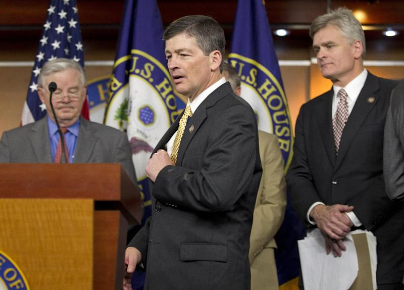 Republican Conference Chairman Rep. Jeb Hensarling, R-Texas, and fellow GOP House members meet with reporters on Capitol Hill in Washington, Thursday, March 22, 2012, after the House voted along party lines to repeal a Medicare cost-control board that's part of President Barack Obama's health care overhaul law. From left are, Rep. Joe Barton, R-Texas, Hensarling and Rep. Bill Cassidy, R-La. (AP Photo/J. Scott Applewhite)