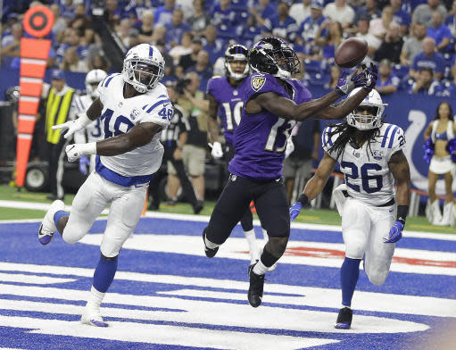FILE - In this Aug. 20, 2018, file photo, Baltimore Ravens wide receiver John Brown (13) makes a catch for a touchdown in front of Indianapolis Colts linebacker Skai Moore (48) and defensive back Clayton Geathers (26) in the first half of an NFL preseason football game in Indianapolis. Brown has scored touchdowns in each of his first two games with Baltimore. It feels great. I know what I can do, Brown said. The Ravens take on the Denver Broncos in Baltimore on Sunday. (AP Photo/Darron Cummings, File)