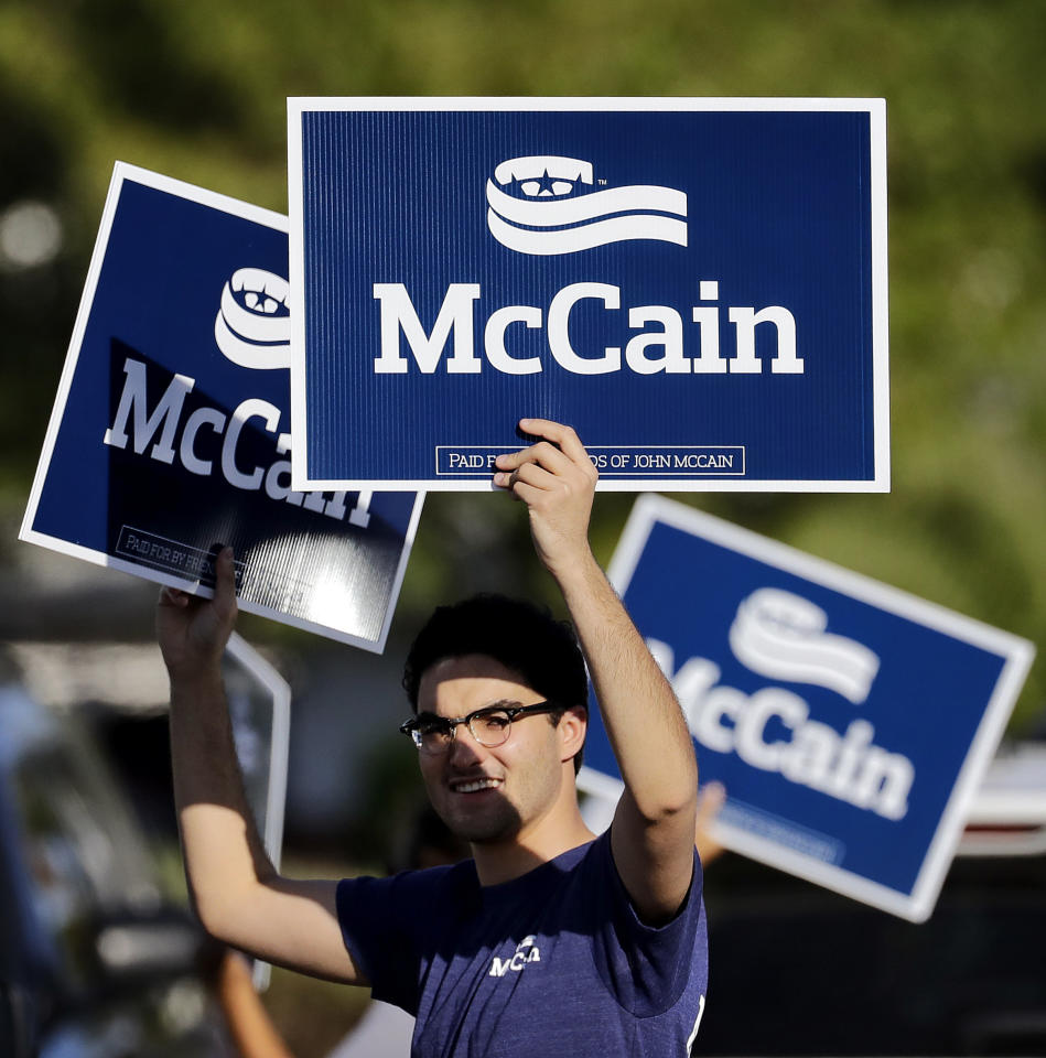 U.S. Sen. John McCain supporters stand outside a polling station, Tuesday, Aug. 30, 2016, in Phoenix. McCain is seeking the republican nomination in Arizona's primary election. (AP Photo/Matt York)