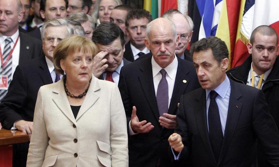 Angela Merkel in 2010 with then Greek president George Papandreou and French president Nicolas Sarkozy at an EU summit in Brussels.